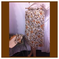 1950's cotton skirt . This adorable skirt has two belts. The waist is elastic and has one pocket on right side. This is vintage and used  no rips tears or stains. 30 inch waist and length is 27 inches. For your protection and mine all items are vedio taped upon packaging. Happy Poshing! now $9.00 or two for $15.00 Skirts