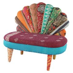 """One-of-a-kind peacock loveseat with mango wood frame. Upholstered with reclaimed Kantha throws.   Product: ChairConstruction Material: Mango wood and vintage, reclaimed Kantha throwsColor: MultiFeatures: One-of-a-kind pieceDimensions: 28"""" H x 42"""" W x 12"""" DNote: Due to the vintage nature of this product, some wear and tear is to be expected. Products may show signs of brand marks scrapes or other blemishes.Cleaning and Care: Spot clean"""