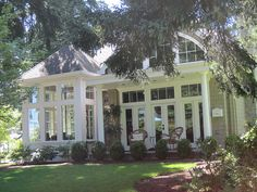 Love the back of this home. Sun room and porch.