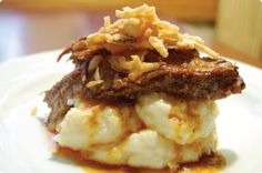 Husband pleaser ... Beef brisket over garlic parmesan mashed potatoes (Slow cooker)- sounds delicious