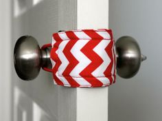 In your quest to make your home safe for the new baby, you may come across a ton of unattractive but essential gizmos and gadgets. Inject a little style to the process when possible-like with this chevron-printed door latch catcher.