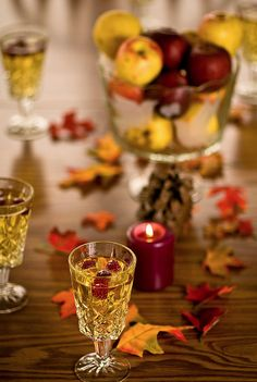 Thanksgiving Table burgandy candles, scatterd leaves & white grape juice
