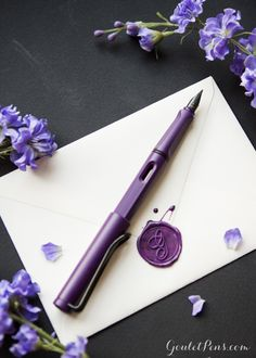 I'd take this fountain pen with me anywhere! Love the purple and matching black trim. Want.