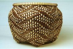 Made a similar basket in a class taught by this artist, Judith Olney, and my fingers bled,  She believes in packing those rows very tightly.  What a beautiful result!     Google Image Result for http://juditholney.com/GVWSGChoice_files/image016.jpg