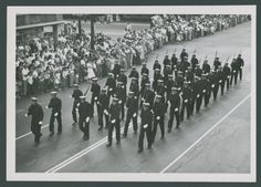 Rice Institute Naval ROTC (NROTC) drill team marching in parade celebrating new Rice Stadium opening, Fall 1950