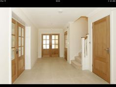 Oak doors and light floors - Before After DIY Porch Doors, House Doors, House Stairs, Windows And Doors, Hall Tiles, Tiled Hallway, White Floorboards, Hallway Colours, Doors Galore