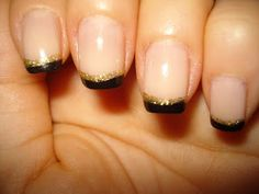 Reverse black and gold french manicure. I have become a fan of the reverse french mani. I did Red and gold for Christmas and then dark green and gold for New Year's. Thinking deep purple and silver for next week.