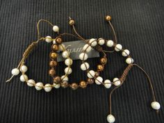 Go fancy, or casual with these Pearl and linen bracelets at Glassando!- This piece has sold but check out similar items at www.glassando.com #Pearls #Bracelet #Unique #Handmade #Jewelry #IowaCity