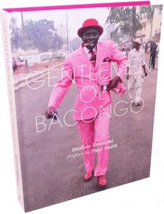 """Gentlemen of Bacongo - A photography book by Daniele Tamagni that captures a sapeur subculture in the Congo called """"Le Sape"""" where men from the slums are flamboyantly attired in expensive suits. A juxtaposition of luxury in the complex backdrop of poverty."""