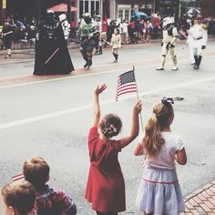 """Children cheer as the Wawa Welcome America Independence Day Parade moves along Market Street through """"the nation's most historic square mile."""" (Photo by M. Stanley for Visit Philadelphia)"""