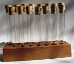 Empty 15 piece test tube spice rack.. $25.00, via Etsy.