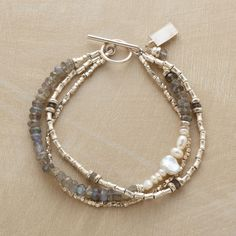 Sterling silver spools and hammered beads dominate two strands; a third is strung with labradorites and varying cultured pearls. Exclusive. Handmade in USA.