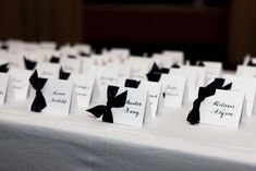 Classic black ribbon and calligraphy escort cards.