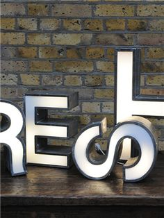 Letter lights - more interesting than wall poetry light letters, marquee letters Signage Board, Wayfinding Signage, Signage Design, Marquee Letters, Light Letters, Illuminated Letters, Furniture Logo, Retro Furniture, Furniture Sale