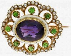 An amethyst, demantoid garnet, pearl, enamel, and gold brooch.