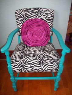 Re-upholstered & painted chair sits in my dining room, thanks to my hubby!