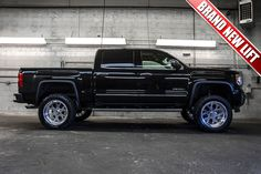 """2014 GMC Sierra 1500 Denali 4x4 Truck with a Brand New 6"""" Fabtech Performance Lift with 20"""" American Force Shield Wheels on 35"""" x 12.50 R20 Fuel Gripper MT Tires For Sale 