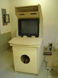 DIY arcade cabinet. OR find a real one (broken) and put the jungle gym tube through it