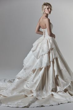 Wessex by Sottero & Midgley. This Elegance satin wedding dress features a gorgeous ballgown skirt, with delicate lace motifs adorning the tiered train, hemline, and bodice. Complete with illusion plunging neckline and half corset, half zipper closure. Western Wedding Dresses, Wedding Dresses Photos, Dream Wedding Dresses, Bridal Dresses, Gown Wedding, Wedding Pictures, Wedding Ideas, Maggie Sottero, Sottero And Midgley Wedding Dresses