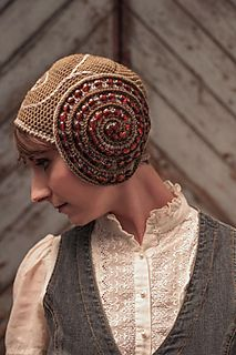 Description The chill of the stratosphere is no match for the warm swirls of wool in this cap. Beaded spirals add shine and structure fit for a captain.