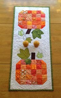 This tutorial shows you how I made the table runner shown.  Parts of the design can be adapted to what you would like your finished table runner to look like.  -Make your pumpkin scrappy, or plan a pa