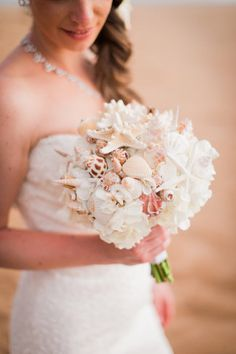 Breathtaking Wedding Bouquet: Beach shell bouquet with white flowers. Click to blog for more gorgeous bouquet ideas. http://www.confettidaydreams.com/breathtaking-wedding-bouquets/ ♥ Styled by Sitting Bella Blooms / Pics: Bella Eva Photography ♥