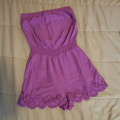 Forever 21 Romper Strapless purple romper with detailing on bottom and cinched waistband. Really cute. Has stains on front bottom that may be able to come out with some help. 100% rayon. Machine wash cold. Forever 21 Other