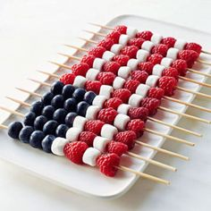 Thread 4 blueberries, 2 mini-marshmallows and 2 raspberries on each of five 10-inch wooden sticks. On the remaining seven sticks, thread 4 raspberries and 3 marshmallows to create this all-American treat. - FamilyCircle.com