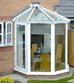 "The ""Bay-Bee"" Small Conservatory- allows a residential door to be positioned in any of the conservatories five vertical window panels, and the extended version which enables a French door to be fitted in the front centre panel. Conservatory Dining Room, Lean To Conservatory, Conservatory Ideas, Conservatory Furniture, Lounge, House Extensions, Small Rooms, Architecture, French Doors"