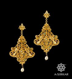 Tree of Life Earrings : On the auspicious day of Eid-ud-Zoha, what better way to celebrate the beauty of our syncretic lives than to eternalize it with this wonderful jewel drawn from an art form heavily influenced by Islamic patronage. The multi-coloured gemstones, the hand-chased motifs, the large pearl drop, and the simplified inverted style of the paradisiacal plant all take us to that sublime heaven of our thoughts n feelings, where symbolism of the Tree of Life becomes us like no…