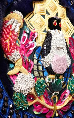 Mary Katrantzou. This embroidery was worked at Hand & Lock in London