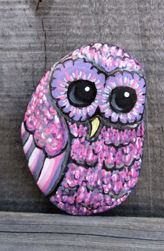 This sweet pink owl was drawn and painted on a smooth, found beach stone happily collected while vacationing in Oregon.  Hes a shy little guy,