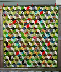 Tumbling Blocks.  This might be a good project for sewing on the train.