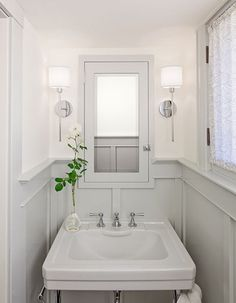 Perfect for the small bathroom-love the gray woodwork!
