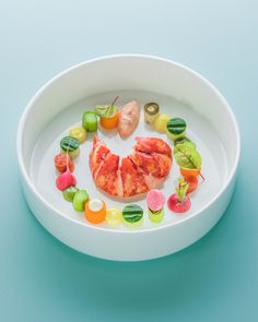 Lobster with watermelon and horseradish. Served with bisque. Food Photography for 2 Michelin Star Restaurant 'Aan de Poel' Amstelveen by Stefan van Sprang.