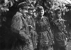 Four rebel Polish soldiers of the Home Army during the Warsaw Uprising, August 1944. The uprising was crushed by the SS. Note the German camouflage tunics worn by the Poles.