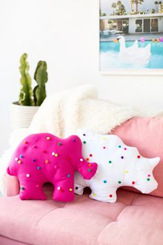 Decorate your couch with pillows shaped like giant animal cookies.