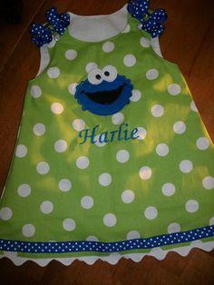Green dot Cookie Monster jumper dress