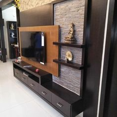 Image may contain: indoor Pooja Room Design, Room Door Design, Tv Wall Design, Lcd Unit Design, Lcd Panel Design, Tv Unit Decor, Tv Wall Decor, Tv Unit Furniture Design, Tv Wanddekor