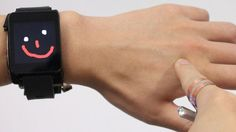 """This Invention Lets You Use Your Skin as Smartwatch Trackpad  Carnegie Mellon University  (PITTSBURGH) — Researchers at Carnegie Mellon University have come up with a way to expand the touch screen on a smartwatch by using the wearer's skin around it.   """"We were looking at the way smartwatches are being used,"""" Gierad Laput, a Ph.D. student working on the team, told ABC News. """"They have to be small for people to wear them.""""   Sometimes the screens might be too small for users' fingers.."""