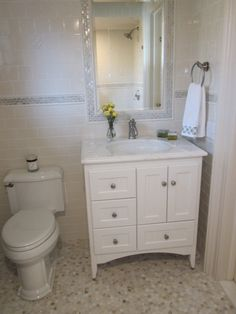 Small Vanity Idea - Like the floor too  The vanity is by Strasser Woodenworks.  The flooring looks very similar to Tarkett Lifetime Rich Onyx Natural Stone skew 38132. You can go to Tarkett's Website and see if there is a retailer near you or search online.