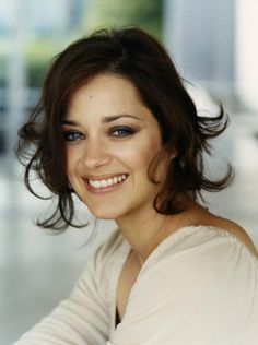 Marion Cotillard. I adore all things French and she can definitely act. Her sultry accent just makes her that much better.