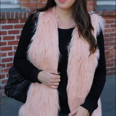 Long Faux Fur Vest Only wore it once for NYE. Very light pink size L from Forever 21. Offers are welcome but please don't low ball :) will post additional pictures shortly. Forever 21 Jackets & Coats Vests