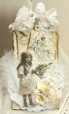 Grunged Vintage Christmas Tag...creamy white...with ribbon & feathers.