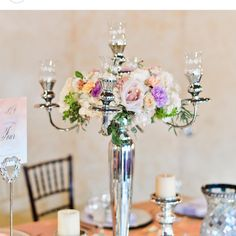 Fresh floral wreath upgrade by @petalsandlucy on silver candelabra