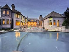 would wrap house in rock and change inside color of pool. Find this home on Realtor.com