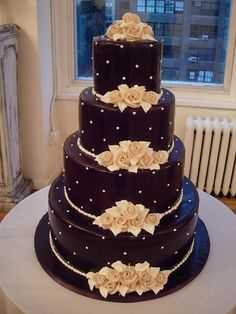 Beautiful and elegant, love the beige flowers against the dark chocolate surface by bobbi