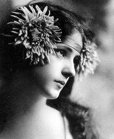 Nesbit wearing flower wreath headband