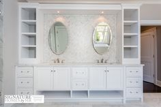 Incredible custom dual sink vanity features countertop shelving on either side of a mini marble herringbone tiled backsplash !