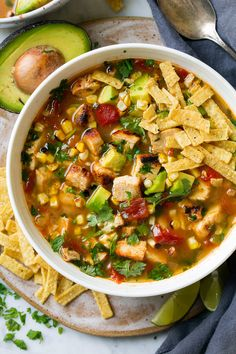 Traditional tortilla soup gets an upgrade with grilled chicken, grilled corn and plenty of diced avocados! Such a delicious summer soup!